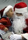 Foto kind bij kerstman