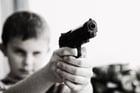 Foto kind met wapen