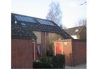 Foto zonne-energie - Zonnepanelen op een dak